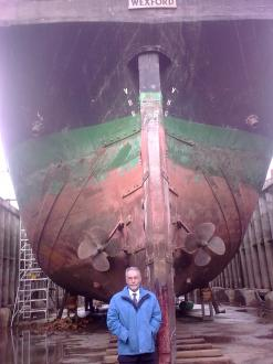 Sean Reidy in front of The Dunbrody in dry dock at New Ross, County Wexford.